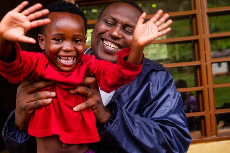 Habumugisha Daniel with VSO staff member Claude Kamba. Daniel attends an early childhood education class in Rwamatamu, based in one of the poorest districts in Rwanda.