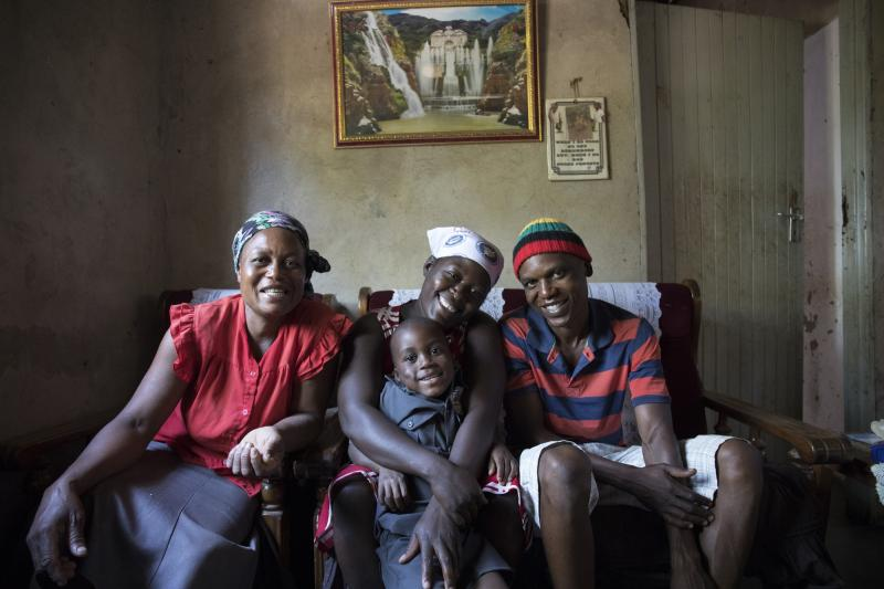 Peer educator with his family at home in Zimbabwe