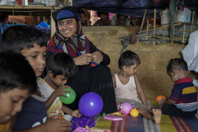 Rohingya mother and children enjoying an education session