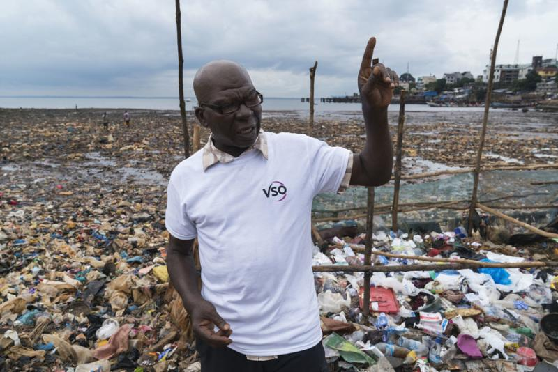 Saidu Turay, stood in Kroo Bay, a slum in Freetown, Sierra Leone.