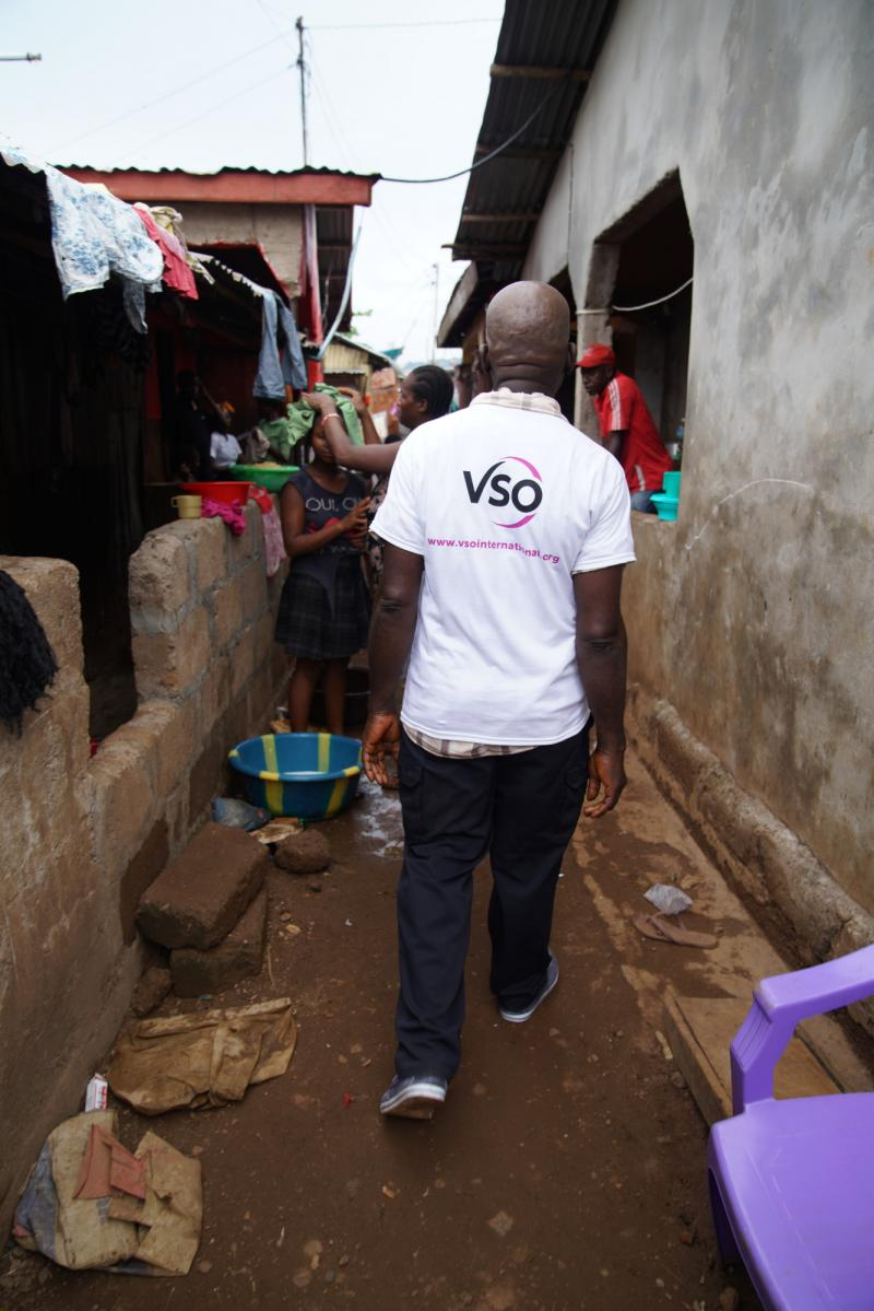 Saidu Turay walking Kroo Bay slum.