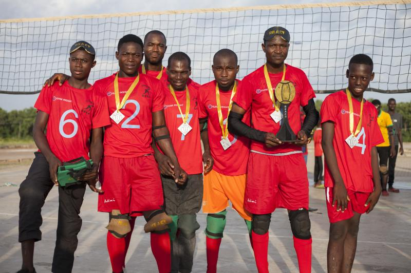 A team of goalball players in Ghana stand proudly with their trophy