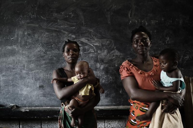 Two young mothers are living temporarily in a school