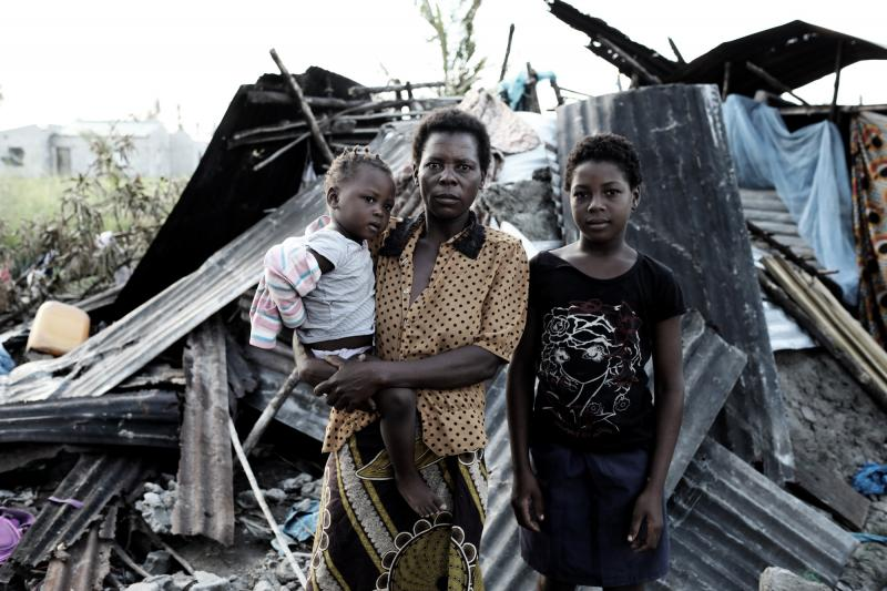 A family outside their destroyed home in Beira, Mozambique