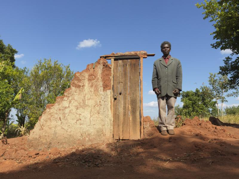 Community leader, Jemusse Jose Chibacha stands in front of a destroyed house in Mudjacure village, Mozambique, after Cyclone Idai.