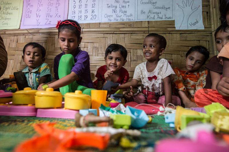 Rohingya children playing with toys in a learning centre in Cox's Bazar refugee camp, Bangladesh.