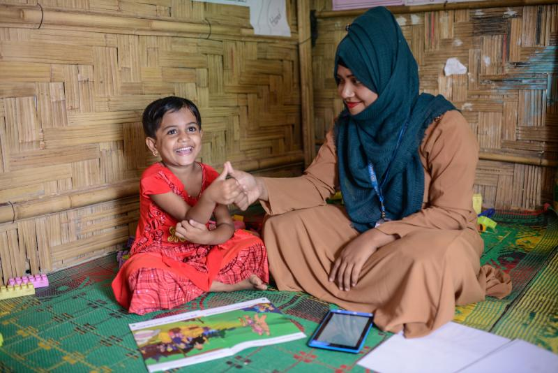 Mabia, 5, at the ECCE centre – 31, supported by VSO, with supervisor Muslima Zannat Rima, the centre is situated at Camp 15 in Jamtoli of Ukhiya, Cox's Bazar, Bangladesh.