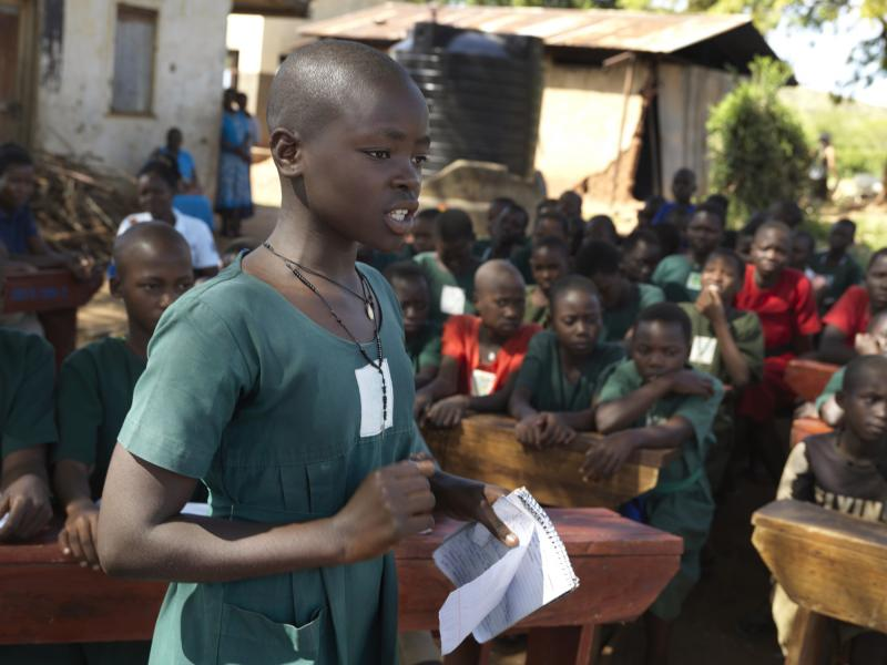 Monica Ayugi,12, addresses the audience while speaking at a debating contest.