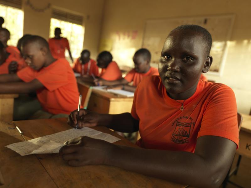 Stella Nagir (18), takes notes during class at Kangole Girls Secondary School in Moroto.