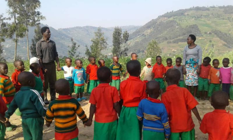 Teachers running classes outdoors to engage children on the Ready to Read project, Rwanda