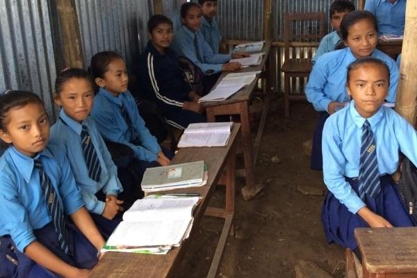 Boys and girls sitting together in nepal