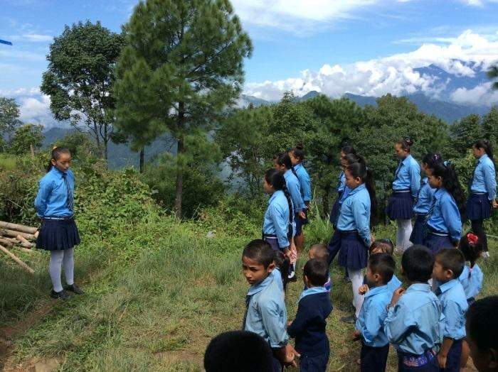 girls taking morning school assembly in Nepal