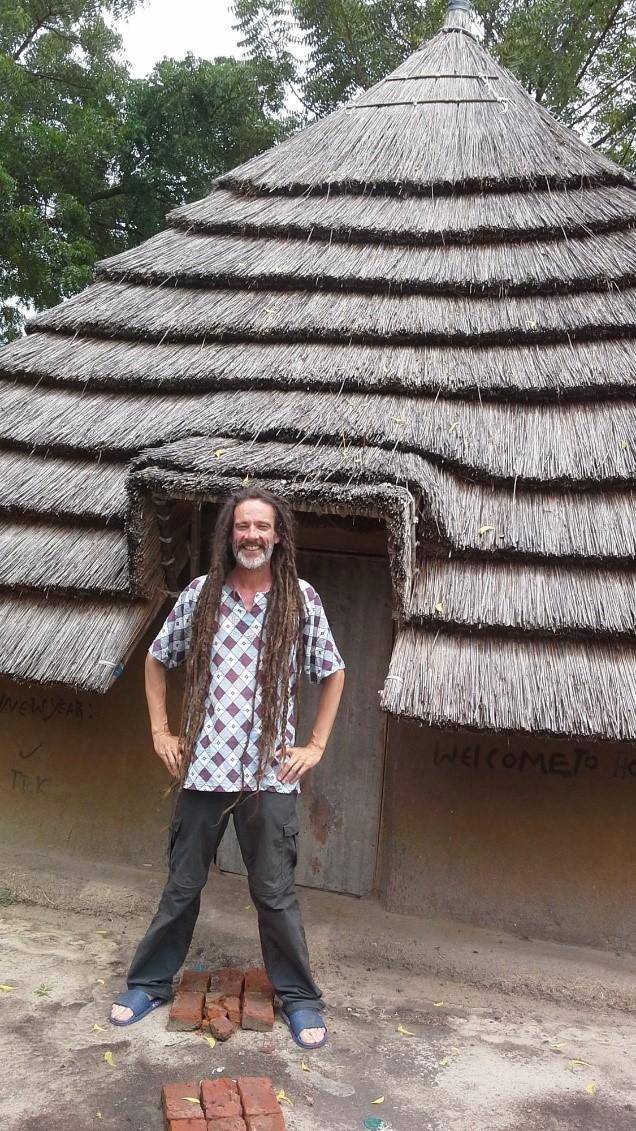 man stood outside a hut in south sudan
