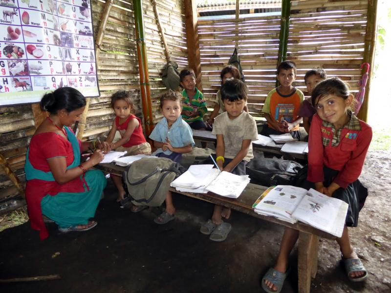 Children learn in a temporary classroom in earthquake-stricken Nepal
