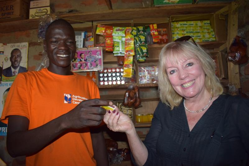 Sue Howes with shop owner in shop.